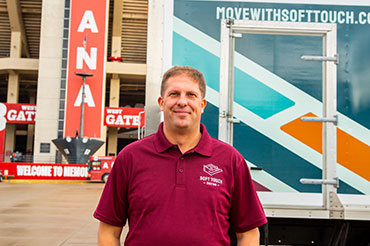 Owner John Craft and Soft Touch Moving truck in front of Indiana University Memorial Stadium