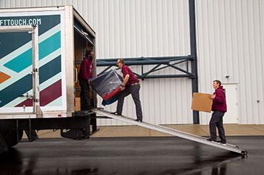 Soft Touch Moving movers packing up a Soft Touch Moving truck