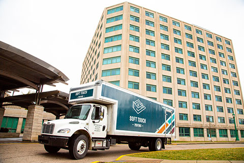 Soft Touch Moving truck outside an Indiana University Dorm