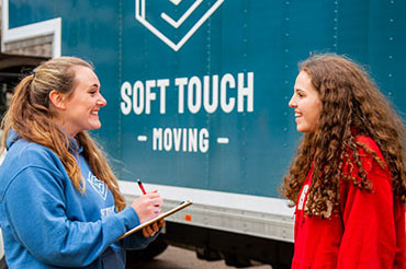 Soft Touch Moving professional working with a customer